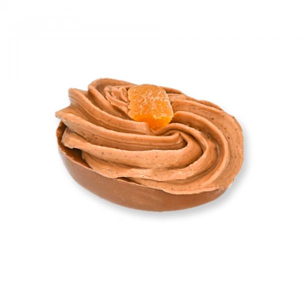 Vollmilch-Schokolade-Ei mit Marille-Marzipan-Fülle und dressiertem Mandelnougat -