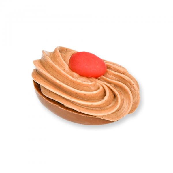 Vollmilch-Schokolade-Ei mit Pflaumen-Fülle und dressiertem Mandel- und Nussnougat -