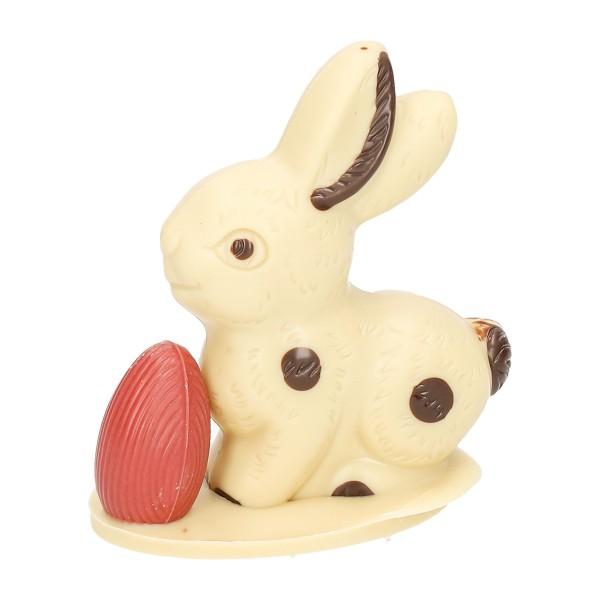 Sitzhase klein mit Ei, Weiß - Schokolade Osterhase