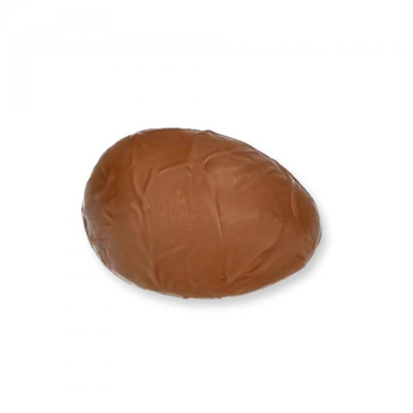 Vollmilch-Schokolade-Ei mit Rum-Fülle